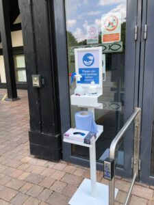 sanitising station with tray outside public building