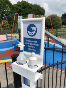 sanitising station with tray outside playground